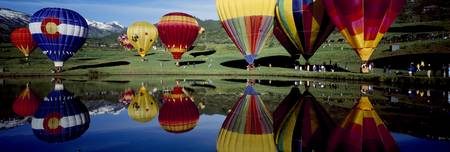 Reflection of hot air balloons in a lake Snowmass