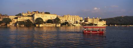 Tourboat in a lake Udaipur City Palace Lake Picho
