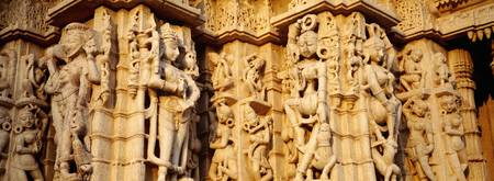 Sculptures carved on a wall of a temple Jain Temp