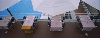 High angle view of chairs and tables at the pools