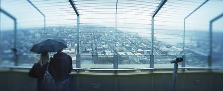 Couple viewing a city from the Space Needle Queen