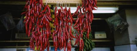 Close-up of red chili peppers hanging in a market