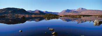 Reflection of mountains in a lake Loch Rannoch Bl