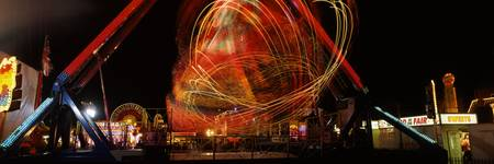 Whirling fairground ride at night Hull Fair Kings