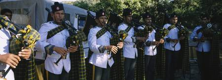 Military band playing bagpipes