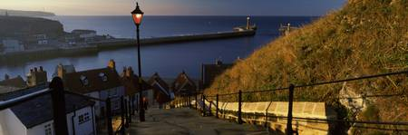 Church steps with harbor in the background Whitby