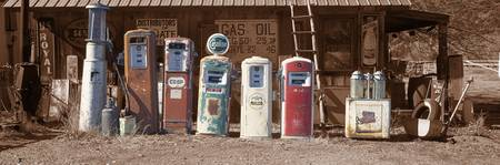 Abandoned fuel pumps in a row at a museum Gasolin