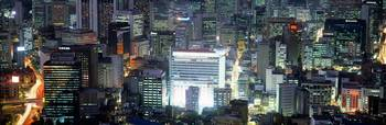 Aerial view of buildings lit up at night