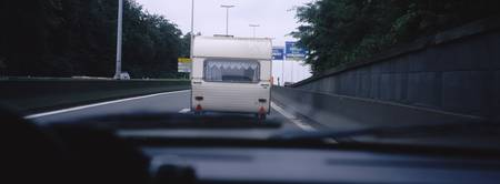 Motor home on the road viewed through a windshiel