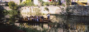 Group of people riding gondolas in a river