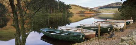 Boats moored at the lakeside Glencorse Reservoir