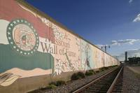 Mural on a wall along a railroad track