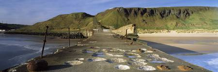 Derelict pier on the beach Skinningrove Redcar An