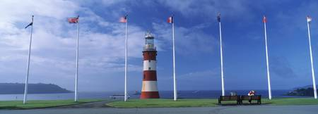 Lighthouse with flags on the coast Smeatons Tower