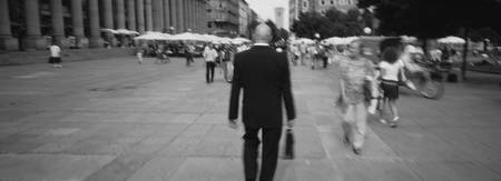 Rear view of a businessman walking on the street