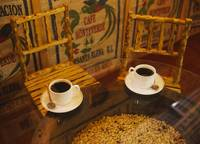 High angle view of two cups of coffee on a table