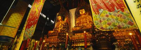 Low angle view of golden Buddha statues