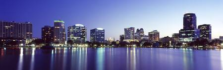 Buildings lit up at night in a city Lake Eola Orl