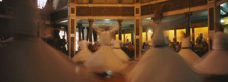 Dervishes dancing at a ceremony
