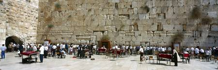 Crowd praying in front of a stone wall Wailing Wa