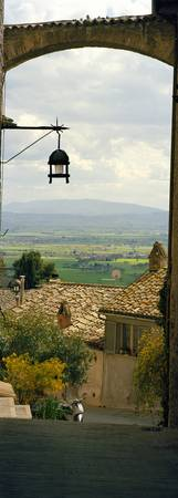 Umbrian countryside viewed through an alleyway