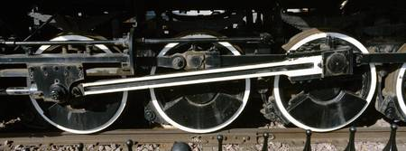 Wheels of a steam engine on the railroad track