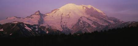 Snowcapped mountain at sunrise