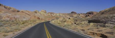 Empty road passing through an arid landscape