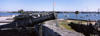 Cannon on a fort with a sea in the background