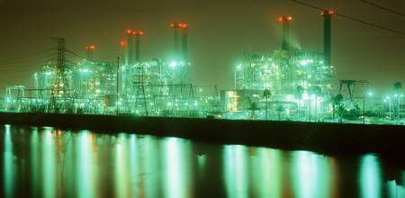 Power station illuminated at night