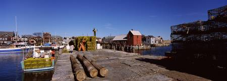 Logs and lobster traps on a dock