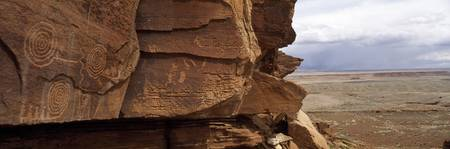 Petroglyphs on rock formations on a landscape