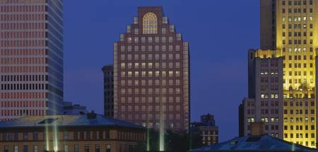 Buildings illuminated at dusk