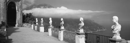 Marble busts along a walkway
