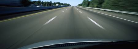 Road viewed from the windshield of a moving car