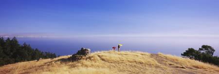 Woman and her child with parasols Mt Tamalpais Ca