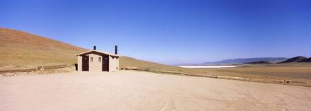 Public restrooms and parking lot on a landscape