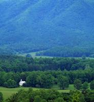 High angle view of misty Cades Cove with church