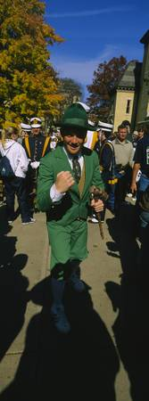 Portrait of a mid adult man in a parade marching