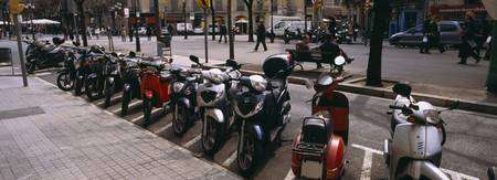 Mopeds parked at a roadside
