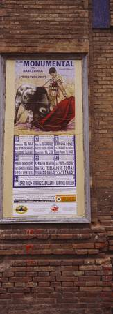 Low angle view of a poster on a wall of a bullfig