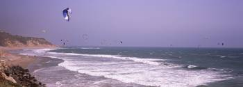 Kite surfers over the sea