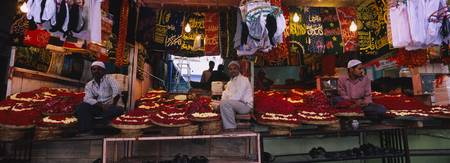Vendors sitting in their market stall