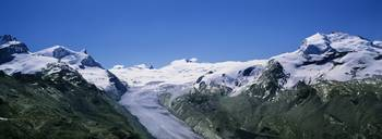Snow covered mountain range with a glacier