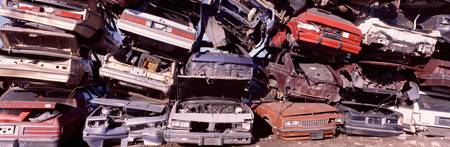 Pile of demolished cars at a junkyard
