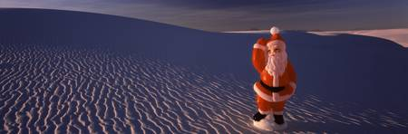 Close up of a figurine of Santa Claus on sand dun