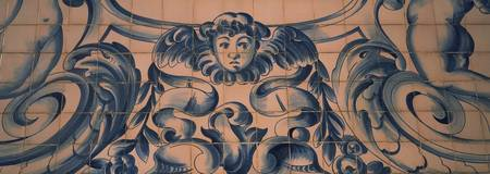 Detail of Azulejo art on the wall of a church