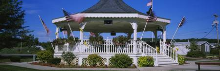 American Flags Swaying Around A Gazebo