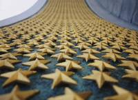 Close-up of stars mounted on the wall at a war me
