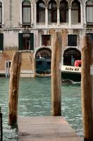 Venice's Canal Grand with wooden pier and poles
